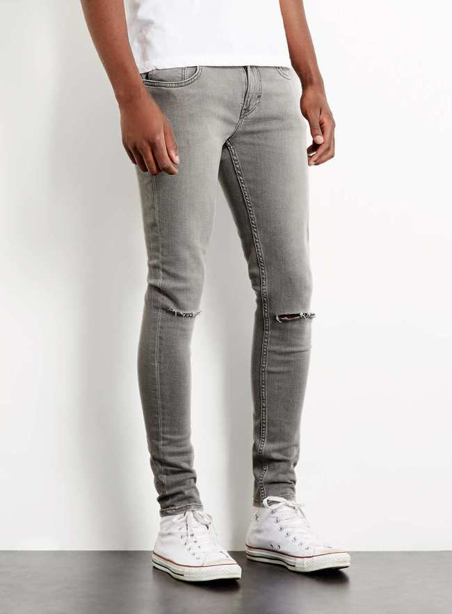 LIGHT GREY KNEE SLASH SPRAY ON SKINNY JEANS