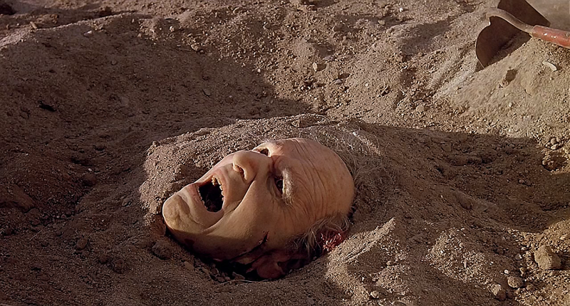 tremors-head-under-hat.png